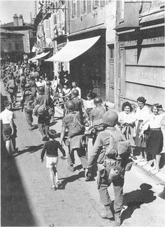 157th Regiment, 45th Division passes through Bourg, Sept. 1944