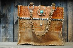 PAIGE WALLACE TAN TOTE. I really like the stamped design in the leather and the turquoise accent bead.