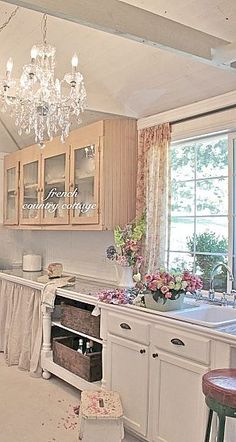 French Country Cottage. Like the open cabinet with the baskets. Like the feet underneath