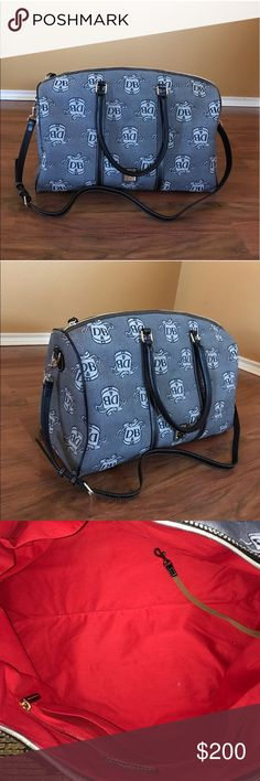 Dooney Bourke Weekender bag In excellent pre-owned condition. Used a few times (deeply bothers me that it is missing one little screw as seen in the picture, otherwise it would be like new)  comes with price tag and the original registration form (hasn't been used- brand spanking new) willing to sell on e-bay for $160 + shipping Dooney & Bourke Bags Satchels