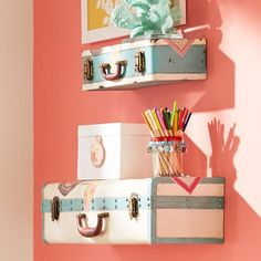 Traveler's Suitcase Shelving -- love them against the melon accent wall! Perfect for a teen girl's room!