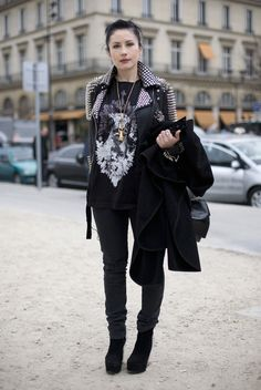 Studded BURBERRY PRORSUM leather motorcycle jacket, ALEXANDER MCQUEEN necklace, GIVENCHY graphic print t-shirt, ACNE black skinny jeans, and black platform PIERRE HARDY boots.