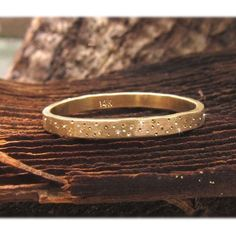 ~ 14k Gold Wedding Band, Thin Gold Band, Gold Stack Ring, Gold Wedding Ring, Gold Wedding Band, Unique Gold Wedding Ring, Organic Wedding Band ~ This magical ring is reminiscent of the silent beauty of the universe... A constellation of a hundred micro stars glitter around the band ~ a photograph doesnt capture how sweetly they really play on the gold. Each sparkle is a burnished spot, catching light against the brushed finish. They are not diamonds. Because its slightly hammered, its a…