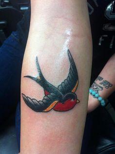 Old school swallow tattoo
