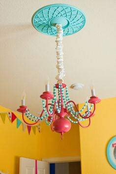 DIY Chandelier Spray Painted Pink with Beads Added - awesome idea for a Dr. Seuss theme!