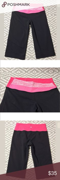 """Lululemon black hot pink Astro crop yoga pants Lululemon  Size 6 Astro crop Black with Various pink shades of waist band Inseam is  15""""  Excellent condition 100% authentic lululemon athletica Pants"""