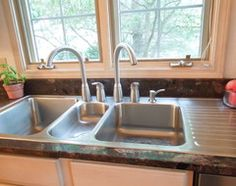 Triple sink with two faucets for a 2 cook household.