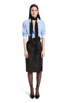 Designed for the women out there looking for office wear with a twist, this basic blue shirt by Altuzarra for Target is pinstriped and elegantly finished with a white collar and cuffs. Go for a smart feminine effect with a flattering shirt. Combine it with a pair of elegant straight-leg pants or pencil skirt and Tod's pumps for a chic on-duty look