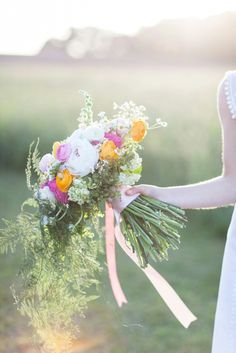 Jenny's whimsical country bouquet - peony, ranunculus, fever few, maiden hair fern, and snap dragons !