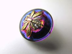 Wow! These gorgeous 18mm Czech glass dragonfly buttons in a purple and hot pink fuchsia with a little flash of royal blue a three dimensional gold dragonfly. They are just stunning! The back is silver