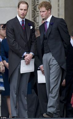 Prince Harry and his brother William chat on the steps of the cathedral