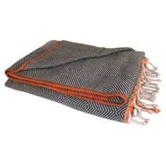 """Add a cozy touch to your favorite chaise or arm chair with this wool throw, featuring a herringbone-inspired motif and fringed edge.     Product: ThrowConstruction Material: Wool  Color: Espresso, tumbleweed and tangerine  Features: Fringed ends  Dimensions:  50"""" x 64""""Cleaning and Care: Spot clean"""