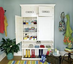 """I love this...""""Armoire turned mudroom""""...would be perfect in our very open foyer!   May-11-2008-Debbie-Travis-Column-MudroomsHalls"""