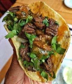 Grilled & marinated skirt steak with onions, cilantro and chile de arbol salsa