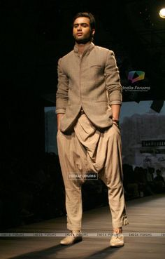 A model showcasing designer Tarun Tahiliani's creation at the Ven Heusen India Mens Week 2011, in New Delhi on Friday. .