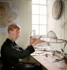RAF Pilot Officer James Harry 'Ginger' Lacey DFM and Bar (credited with 28 enemy aircraft destroyed), hard at work on a model aeroplane in Squadron's dispersal hut at Colerne airfield, Wiltshire, England, May