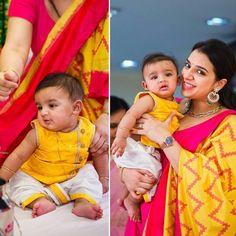 Mom in pink anarkali n yellow ikat dupatta son in dhoti n yellow top