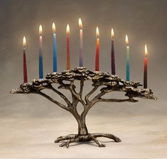 Metal Menorah - Nestled in the boughs of this acacia tree are nine candleholders to mark the days of Hanukkah. A charming addition to your holiday home, this sand-cast bronze candelabrum also provides a sculptural accent throughout the year. It is designed to be a three-dimensional tabletop piece to be viewed from either side, with equal artistic value. The weight is approximately 4.5 pounds. Uses standard menorah candles (not included).