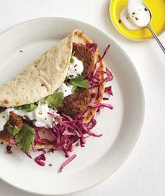 Lentil Fritter Pitas With Red Cabbage Slaw recipe from realsimple.com #myplate #protein #vegetables #vegetarian
