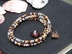 Four Strand Memory Wire Peanut Beaded Bracelet With by KikisJewels, $8.50