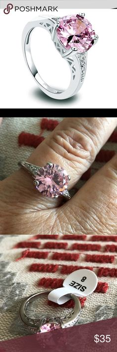 Stunning Pink Topaz Sterling Silver Ring Size 8 Gorgeous ring!! The crystal detail on each of the large center stone is amazing! Center stone is approx 6mm x 6 mm. Size 8. Nwt Jewelry Rings