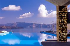 Astarte Suites, Santorini This view is picture perfect, take a look at 10 more hotels with magnificent views. http://worldhotelsandresorts.net/10-hotel-rooms-with-spectacular-views/