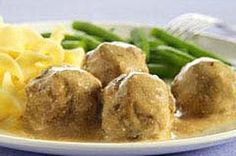 ~Swedish Meatballs~   1-1/2  lb.  ground beef;       1  pkg. Stuffing Mix for Pork;       2   eggs, lightly beaten;       1  small  onion, finely chopped;       1-1/4  C water;       1  jar  (12 oz.) beef gravy;       1/2  C Sour Cream