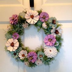 Want a wreath to enliven any room in your home? This unique hand painted wreath will do the job. Soft greens, pinks and cream colors unite to create a soothing blend. The wreath measures 13.5 x 13.5. Pine Cones are wired and sprayed with an acrylic coat.
