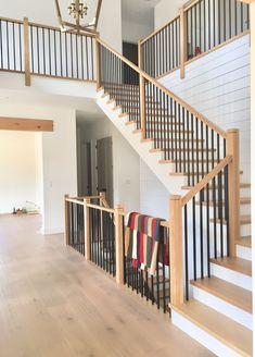 This design cel Interior Stair Railing, Modern Stair Railing, Stair Railing Design, Modern Stairs, Wrought Iron Staircase, Redo Stairs, Staircase Makeover, House Staircase, Staircase Remodel