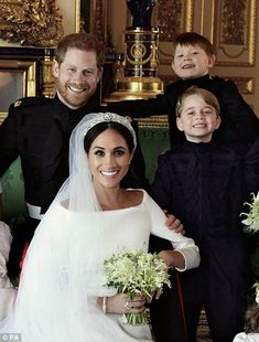 Prince George steals the show in Harry and Meghan's wedding portraits | Daily Mail Online