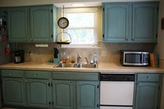 Painting kitchen cabinets with Annie Sloan Chalk Paint.