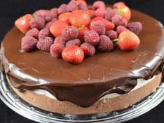 This is such a beautiful cake from Momsdish.com. Want to try it with melted chocolate truffles from costco for the topping. hmmm. mmmmm.
