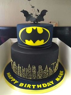 This is a cake I made for a young 50th year old Batman fan! The base is made of double chocolate biscuit cake and the top tier is made of a cake dummy.