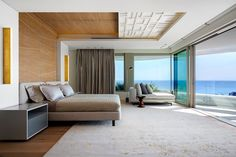 Incredibly spacious modern bedroom with ocean views South Africa coast [18001200]