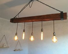 Check out our wood beam chandelier selection for the very best in unique or custom, handmade pieces from our chandeliers & pendant lights shops. Shop Lighting, Track Lighting, Chandelier Pendant Lights, Wood Beams, Ceiling Lights, Yorkies, Home Decor, Etsy, Living Room
