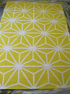 d.i.why not? groovy modern lemon yellow geometric starburst rug- best tip: FABRIC MEDIUM- found in the art supply section and basic latex wall paint.