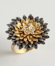 Aishwarya:  gold and silver diamond flower ring  $825.00