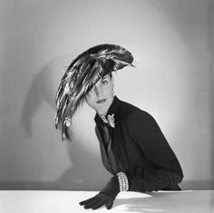 Model is wearing feathered hat by Jacques Fath, photo by Willy Maywald, 1950