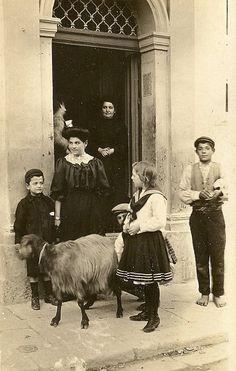 Family & goat herder selling really fresh milk, Malta 1900 by Lea Francis Ellis, via Flickr