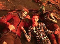 Star-Lord, Spider-Man, and Nebula posing for pictures in