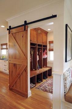 Mud room design with sliding barn door.