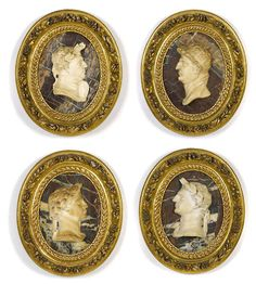 A set of four Italian carved marble portrait panels 17th/18th century