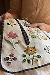 Embroidery with fine thread.  Pocket.