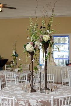 lilac, ivory, and green centerpiece; wrought iron centerpiece; lace linens  www.significanteventsoftexas.com