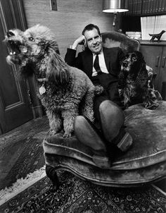 Former Vice-president and future President Richard Nixon looking happy with his two dogs in 1964