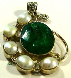 "Artisan Designed Pendant. Featuring Green Emeralds (28 Cttw) and 5 Freshwater Pearls set in Sterling Silver...Hallmarked .925. Approx. 1-3/4"" x 1-1/4"" widest.  Style: Pendant ~ Main Stone: Green Emerald ~ Carat Total Weight 28 Cttw ~ Main Stone Color: Green ~ Main Stone Treatment: Traditional, Normal Enhancement ~ Metal: Silver ~ Condition: Excellent ~ Metal Purity: .925, Sterling ~ Size: 1-3/4"" L  www.etsy.com/shop/SylCameoJewelsStore"