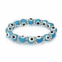 Baby Blue Evil Eye Bracelet with Clear Swarovski Dividers. Evil Eye Bracelet Olympia  Beads & Charms. $8.95. One Size Fits All. Stretch Bracelet