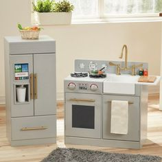 Looking for an abundance of space to store all your favorite farm friendly feeds. Teamson kids modern white brass handled contemporary kitchen is the superb piece to store side by side in mom and dad's kitchen. Little ones will squeal with joy as they create pretend cuisine to satisfy everyone's palates. Gas switch is rotatable to make multitasking in the kitchen easy as pie. Kitchen features a smart screen and water cooler on the door to make getting ice or a refreshing glass of water easy…