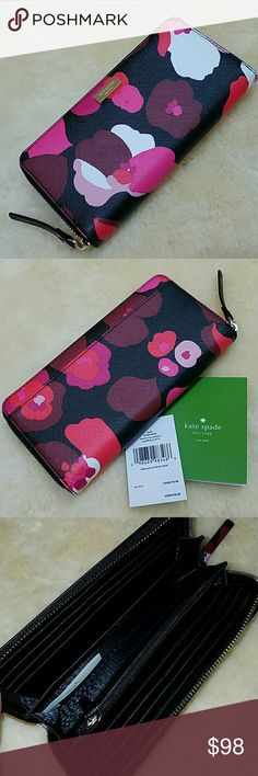 Kate Spade Laurel Way printed Neda Wallet Kate Spade Laurel Way printed Neda Wallet Wonder Floral Saffiano Leather WLRU2680 Pink/burgandy/white floral on black background with gold tone hardware Zip around wallet accented with Kate Spade name plate on the front and a full length slip pocket on the back Top stitch detailing throughout The interior is black leather with black KS fabric and features a zippered compartment, 12 card slots and multiple full length bill compartments Brand new and…
