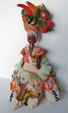 I've blogged about dolls with fruity hats before, but this one is unusual in that she has a crazy assortment of vegetables on her head.